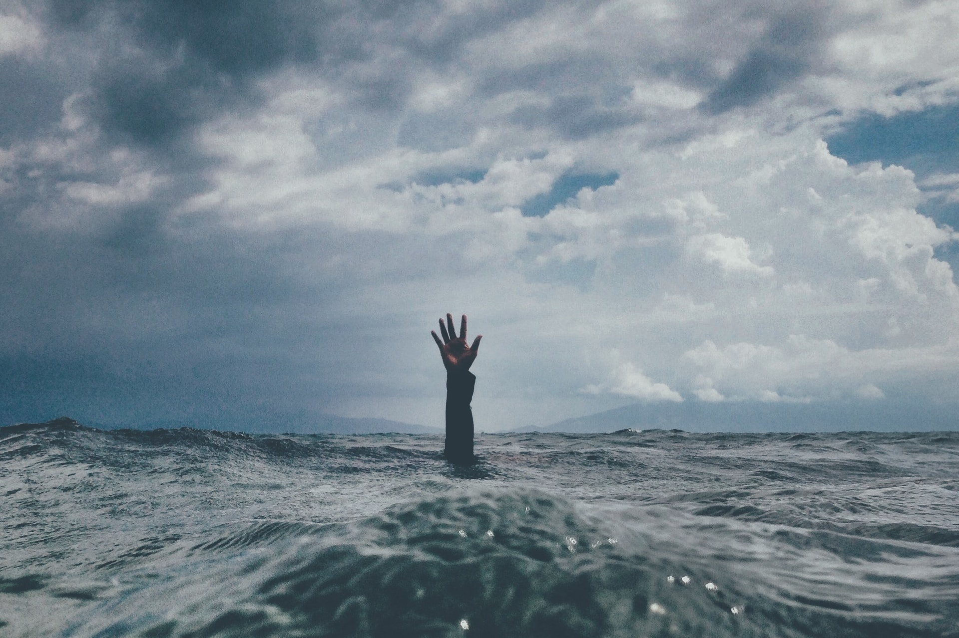 Hand sticking out of ocean