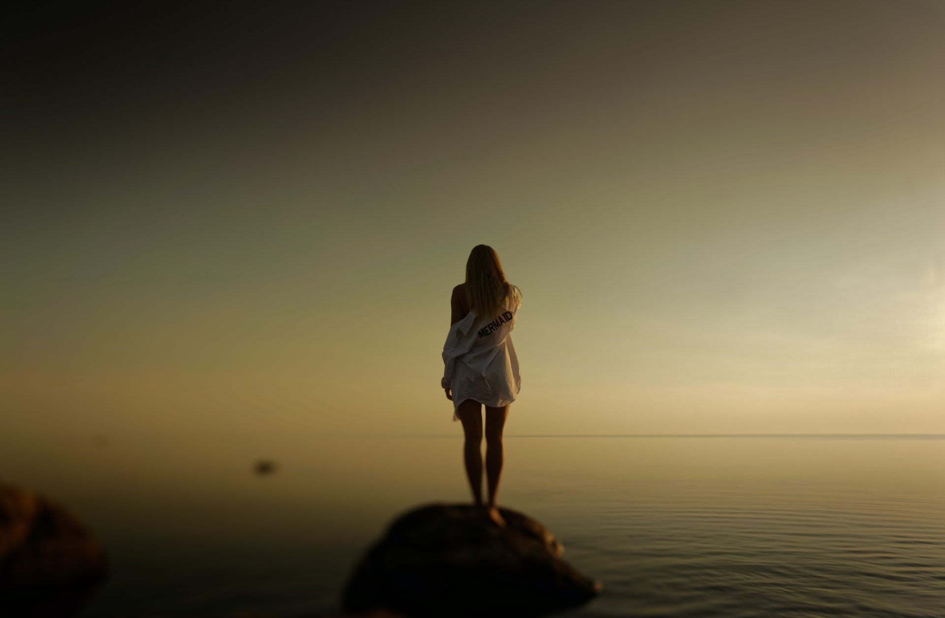 woman standing over foggy body of water